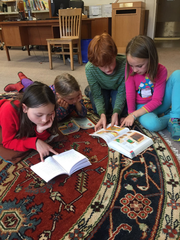 3rd grade students in the library