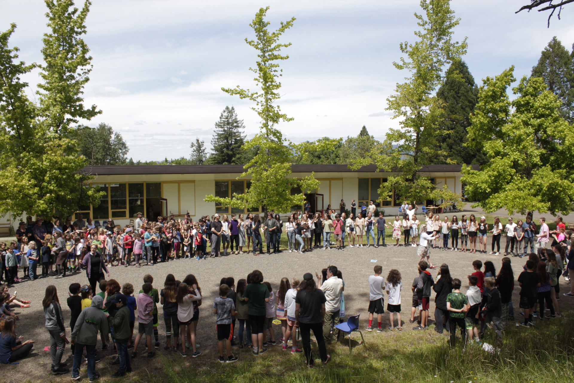 Students sing together for the last day of school [click image to see entire picture]