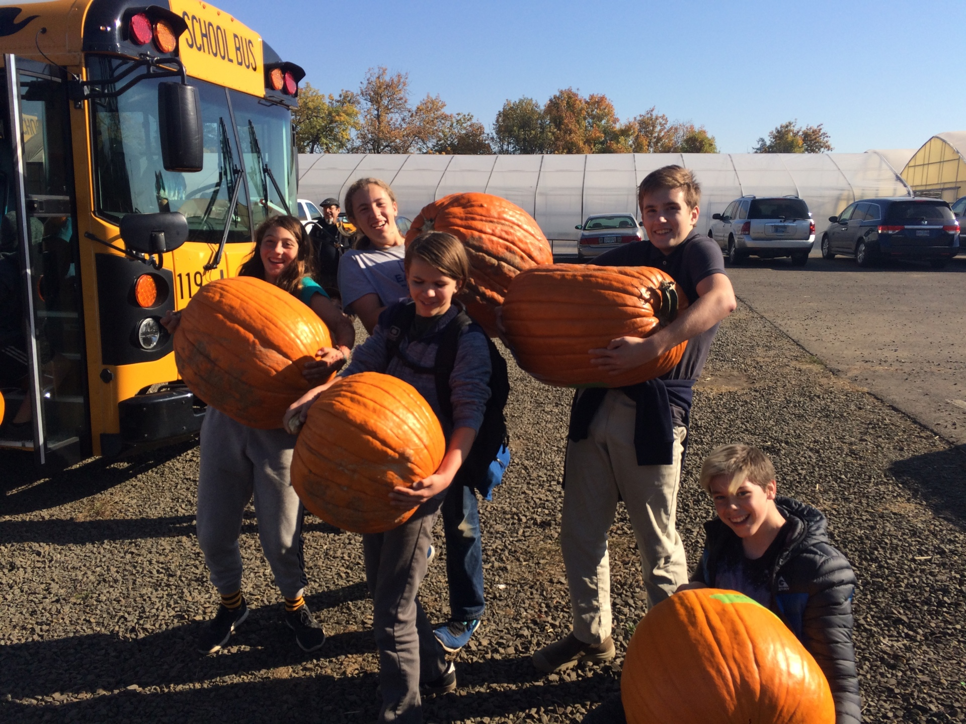 Eighth grade students pose with their pumpkins [click image to see entire picture]