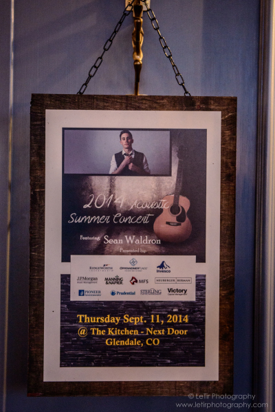 Promotional poster featuring event sponsors and the evening's headline entertainment