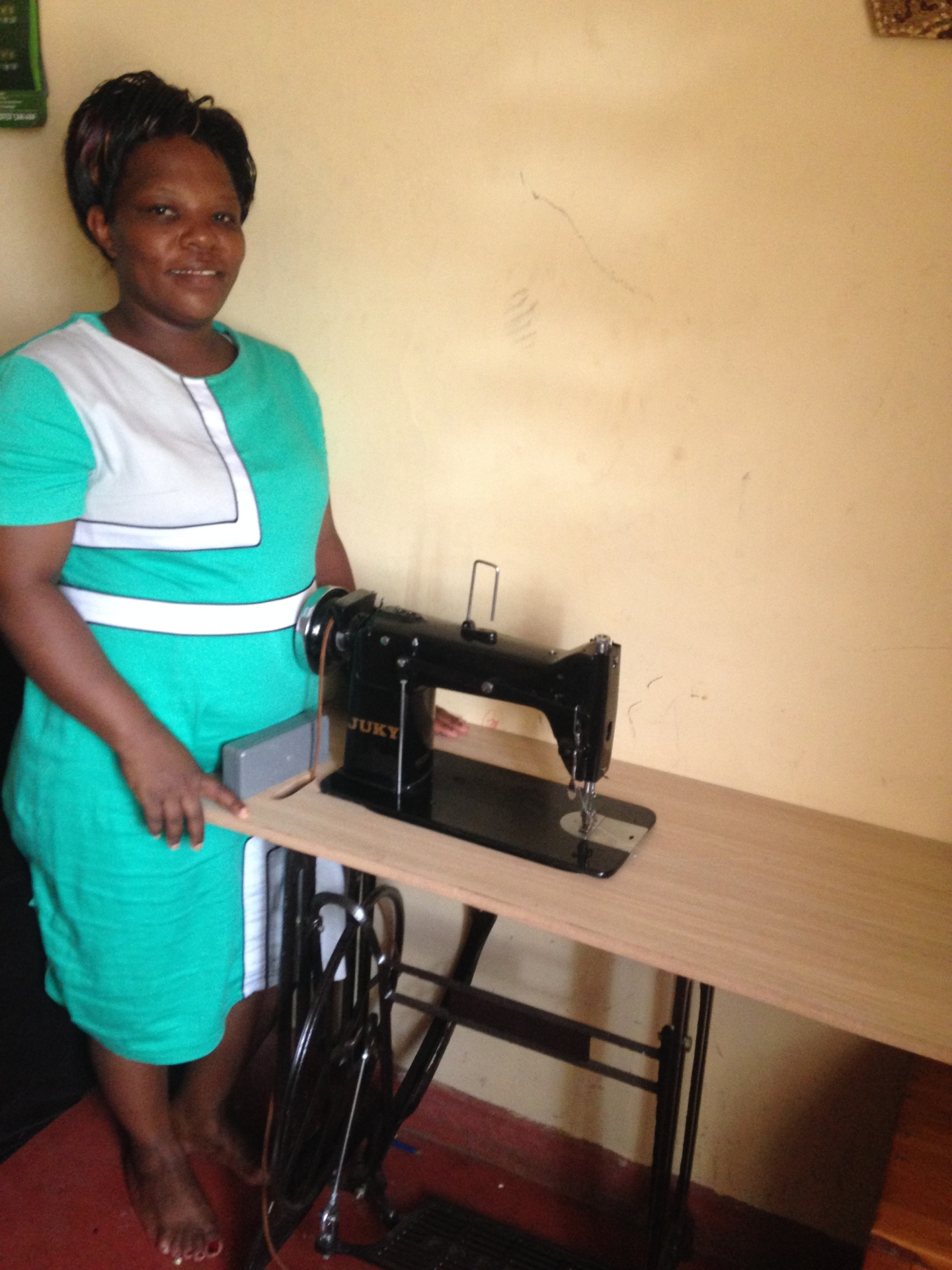 Pastor Essy with sewing machine