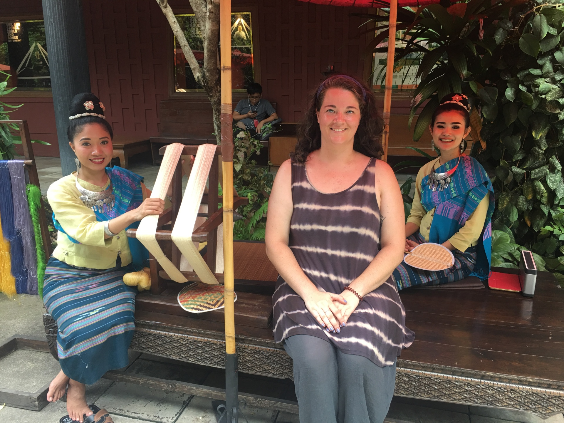 A photo of me with two Thai silk weavers.