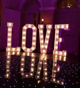 simply stunning weddings. venue decor. white LOVE letters