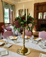 Gold Candelabras with floral display. wedding centrepieces