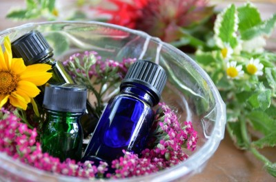 essential oil bottles in bowl