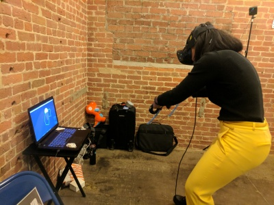 TangramsVR, a virtual reality puzzle game for the Oculus Rift and HTC Vive being demoed at an event.