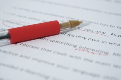 red pen on corrected edited text