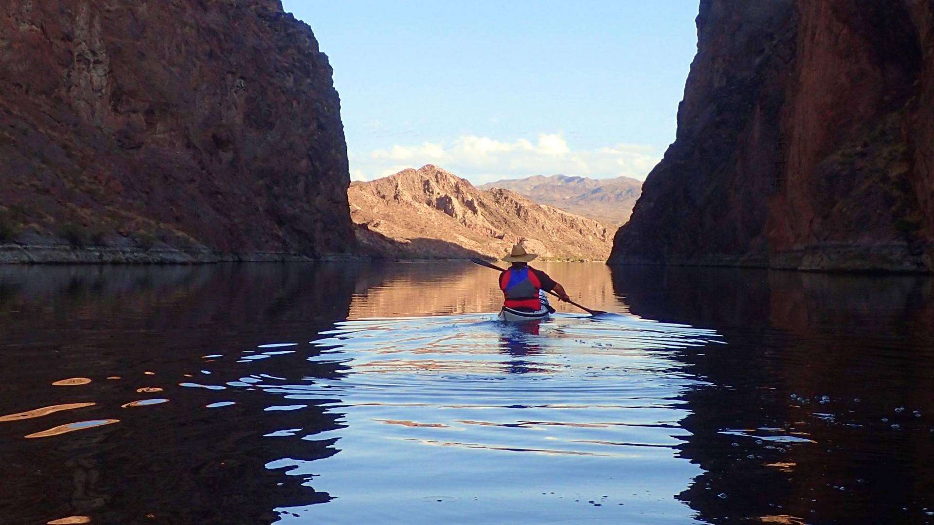 Morgan Eisen paddling through the narrows of the Black Canyon