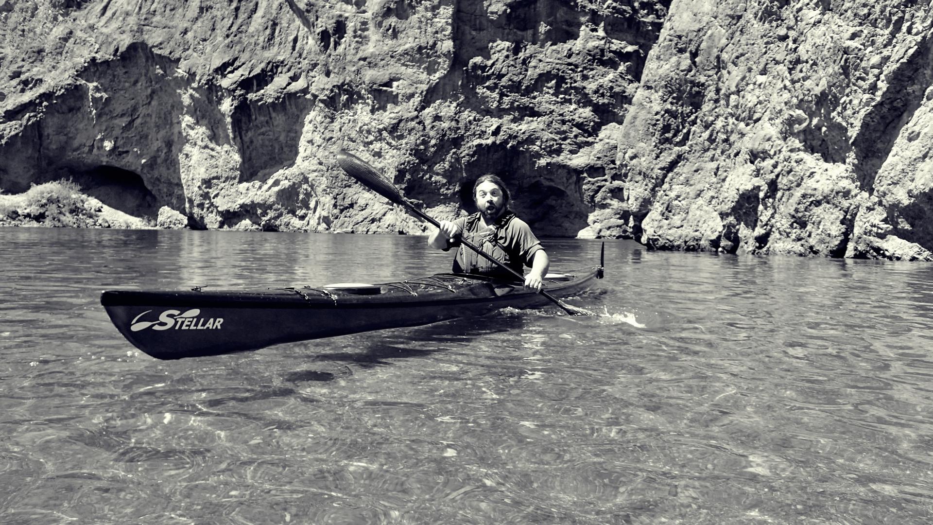 Morgan Eisen paddling a Stellar Kayak in Emerald Cove