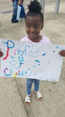 Beautiful child protesting for her right for quality healthcare