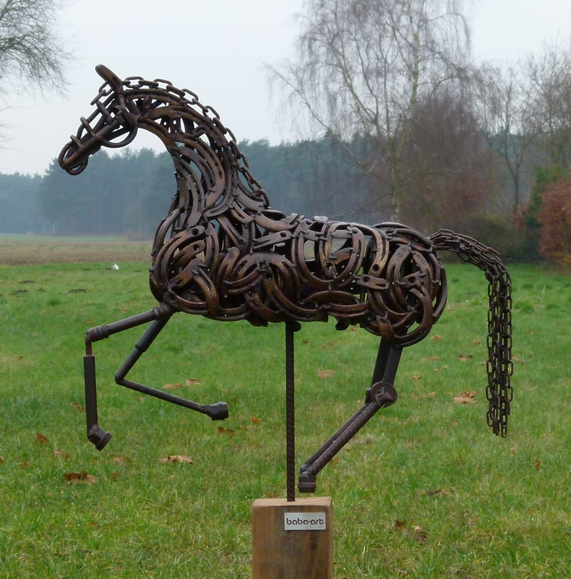 Galopping horse on wooden block