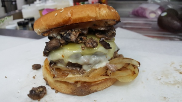 Organic Baby Portobello Garlic Mushrooms over Grass Fed Beef Topped with Mozzarella & Swiss