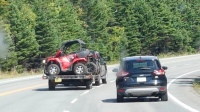 A picture of atv's being hauled on a trailer heading to Newfoundland