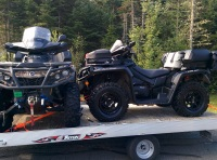 A picture of a cammo Can Am Outlander 650 XT and a black Can Am Outlander 1000 XTP