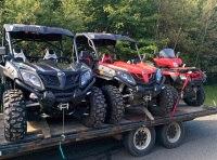 A picture of two CF Moto Zforce 500 Side By Sides and Honda Foreman on a flatdeck trailer