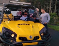 A picture of a yellow and black Can Am Commander 1000 XT with overhead light bar