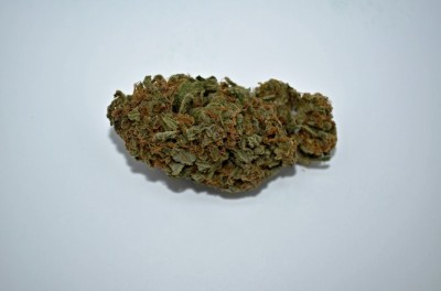 Cannabis PinkLady Strain on white back round with review