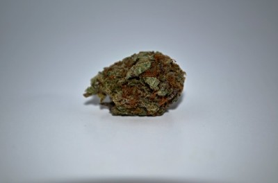 Purple Voodoo Cannabis on white backround with review