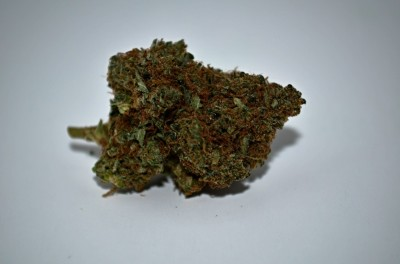 Chemo Cannabis review on white backround with Green Quality review