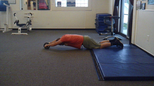 Ab wheel rollouts: An advanced core exercise