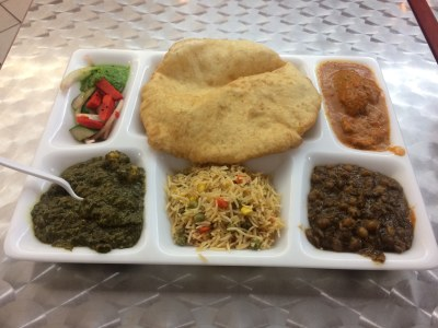 veggie thali moti mahal channa bhatura Indian food saag malai kofta rice pilau pickled carrots