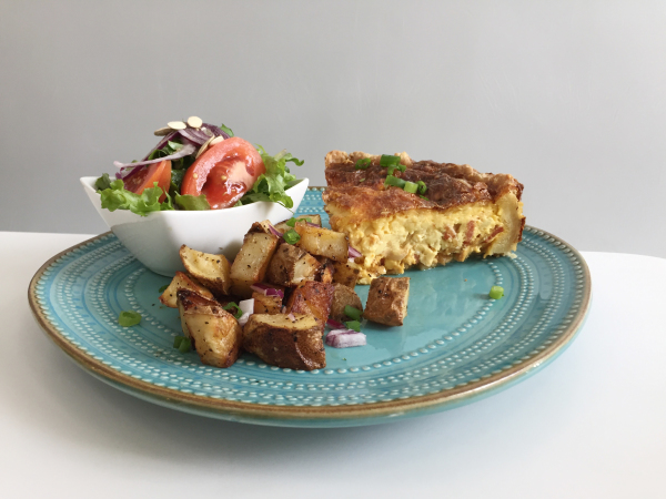 Quiche, fruit, and hash browns