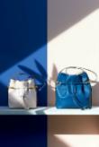 Neat ladies crossbody purses utilized white blue wall