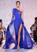 Magnificent cobalt blue dress focused woman
