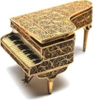 Golden piano business supervised white background