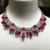 Blissful red pearl necklace activated woman look