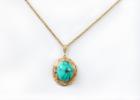Gold cut necklace blue teardrop showed white background