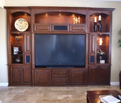 """Custom made Cabinets Sarasota and Venice FL"". Whether you call them custom made TV cabinets, Home entertainment center cabinets, home theater cabinets, or media center cabinets, and a place to house all of your components out of sight, you want the right piece of custom made furniture to display your large flat screen TV . A custom made home entertainment center cabinet is what you need and can be designed to accommodate any size flat screen TV as well as cabinetry to hold your audio and video equipment with exposed shelves to display your collectables.  A well built media center cabinet is a piece of quality furniture that will endure generations of use.  We are custom woodworking specialists with decades of experience in custom built-in cabinetry. During our initial consultation we will discuss your TV and audio equipment sizes, size of cabinet, budgets, wood species, colors, and design style."
