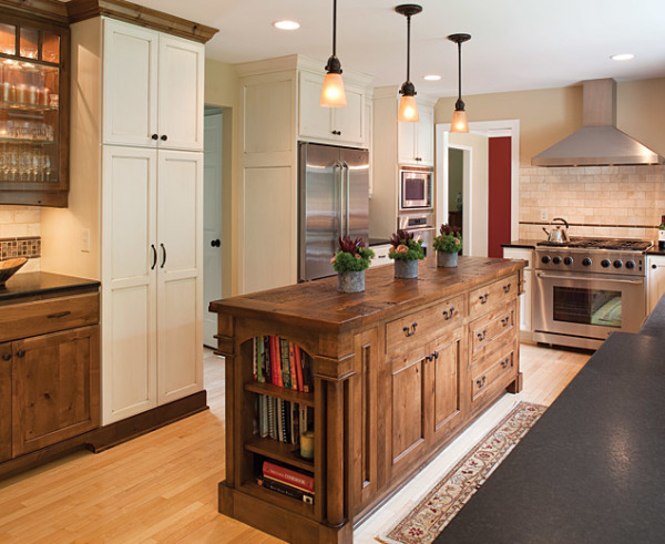 New Kitchen remodel with custom gas range hood, wall ovens, custom LED undercabinet lighting with butcher block countertop.