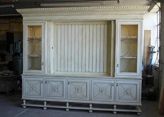During - the process of making the TV cabinet to optimize the space to accommodate a large flat screen TV and shelving.