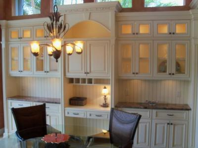 Custom made dinning room hutch with glass cabinets and shelves, TV cabinet, and custom made dinning room table in Longboat Key, Florida.