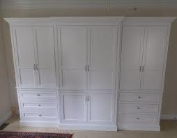 Custom made closet to look like furniture, custom made armoure and built-in closets made with real wood.