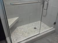 Frame-less glass shower door and panel Sarasota Florida