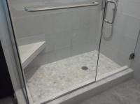 Frame-less glass shower door and panel Sarasota Florida