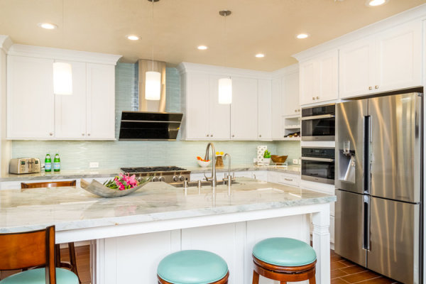 Complete kitchen remodel in Englewood FL with white shaker style cabinets and marble countertop