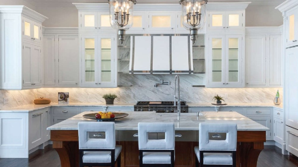 """Kitchen Remodeling in Venice Florida"". This modern contemporary Kitchen remodel in Venice, FL. Is designed with a face frame kitchen cabinet with white shaker style cabinet doors and soft close drawers. As a well known and experienced ""Kitchen designer in Venice, FL"" is also a master craftsman bringing over 30 years of experience to your ""kitchen renovation"" We are members of the ""Sarasota Chamber of Commerce"" and the ""Venice, Florida Chamber of Commerce"", as well as the ""Longboat Key Chamber of Commerce"" and our 11th year membership in the ""National Kitchen and Bath"" Association.  James Anderson LLC Design and Build Co, is one of Venice Florida's most trusted and experienced Kitchen remodeling company. This beautiful kitchen remodel in Venice FL, was a complete home improvement including installing new modern style kitchen cabinets, center Island with snack bar and under-mount sink with granite countertops. The custom-made Butler pantry has ample storage with extra pull-outs. The new kitchen lighting features state of the art LED under-cabinet lighting and plenty of overhead LED lighting to make meal preparations much easier. The cabinet finish is painted modern style with the center Island being an accent color of a rustic European finish to give it the antique reproduction style. The tray ceiling in the Kitchen has indirect LED lighting behind the crown moldings with a ceiling fan."