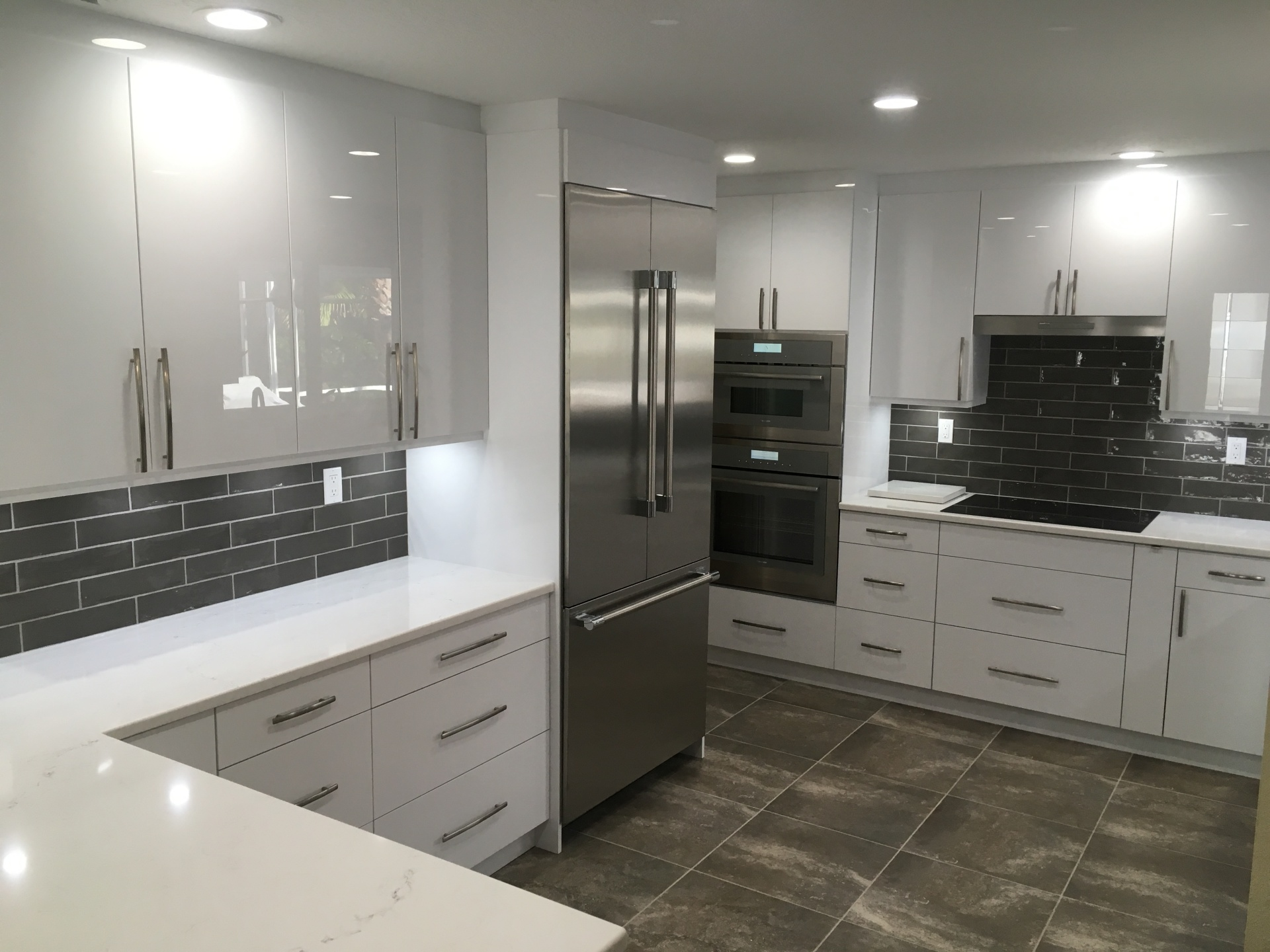 White acrylic cabinets designed and installed in Venice FL