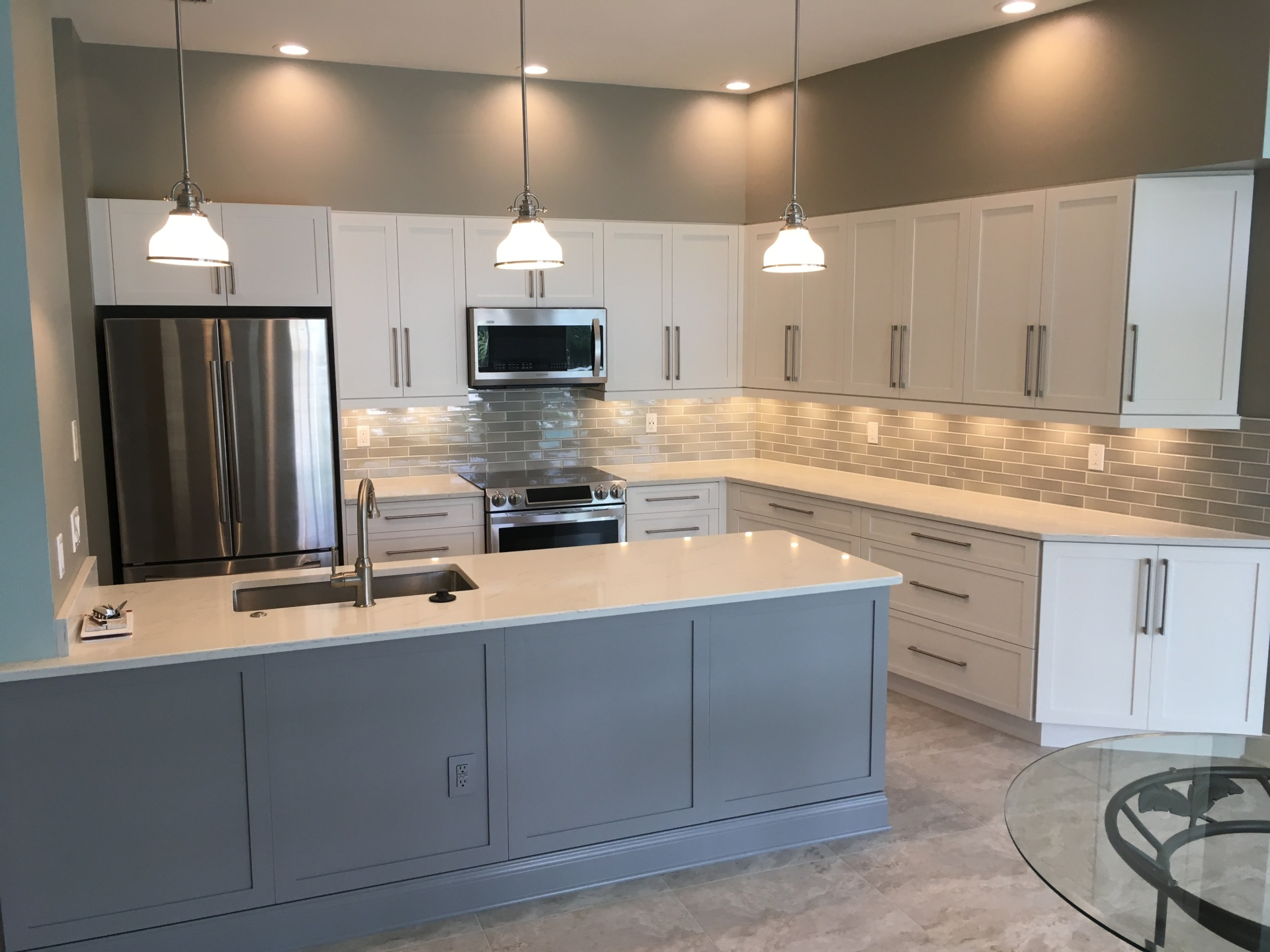 Custom made white shaker cabinets installed in Sarasota, FL