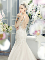 Low back lace trumpet bridal dress with back pearl necklace detail
