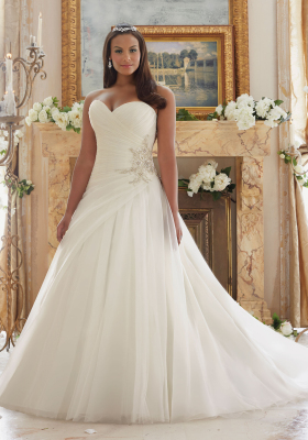 Strapless organza a-line wedding gown. Bridal dress line designed exclusively for plus size brides