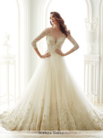 Princess ballgown bridal dress with wide lace hem detail and sleeves