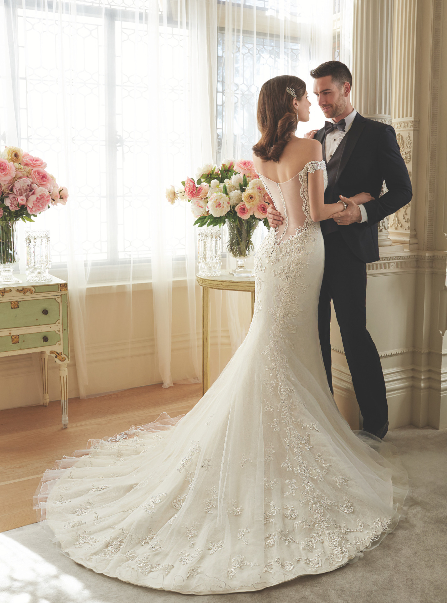 Very low sheer back lace bridal dress with off shoulder cap sleeves