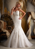 strapless beaded lace mermaid bridal dress with empire waist detail