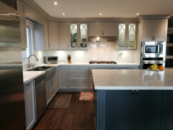 Light grey kitchen with dark grey island