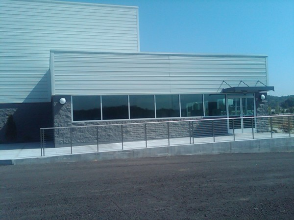 .  Ohio Steel Construction building with stone wainscot wall.  Steel building with office front including awning.