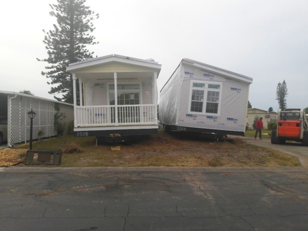 Both sides of new Jacobsen mobile home placed